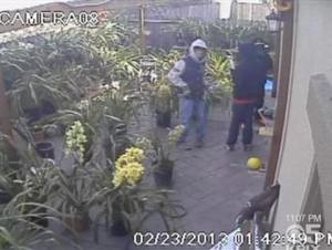 This surveillance image shows three men preparing to break into an Arcadia Park neighborhood home in Oakland. (CBS)
